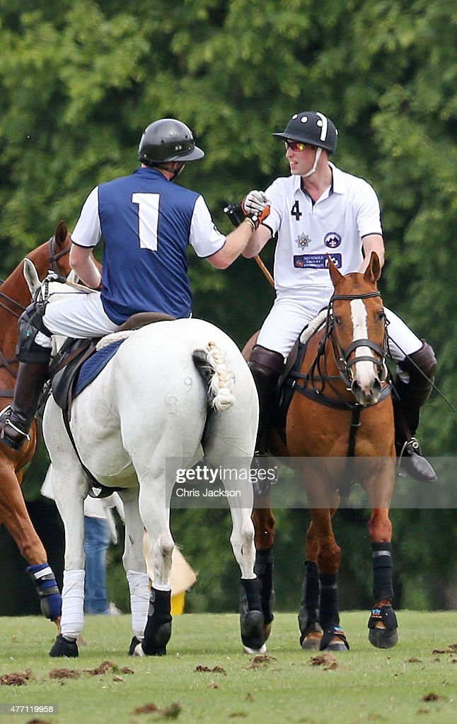 Prince Harry and Prince William, Duke of Cambridge shake hands at the end of the Gigaset Charity Polo Match at Beaufort Polo Club on June 14, 2015 in Tetbury, England.