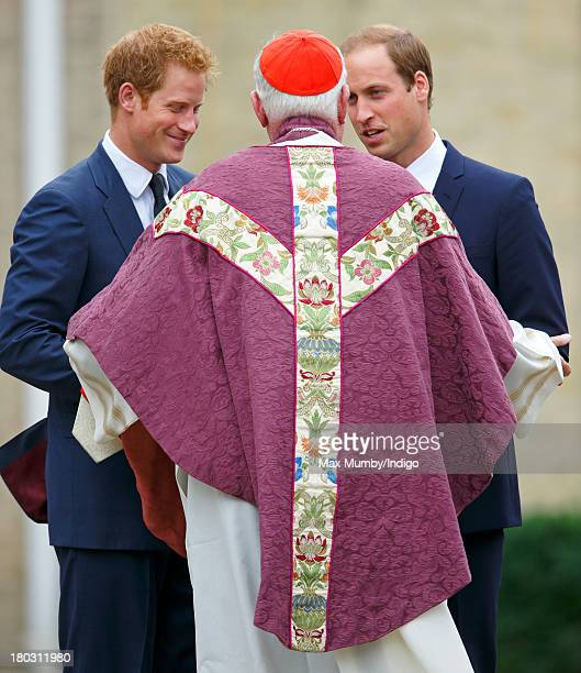 Prince Harry and Prince William Duke of Cambridge talk with Cardinal Cormac MurphyO'Connor as they attend a requiem mass for Hugh van Cutsem who...