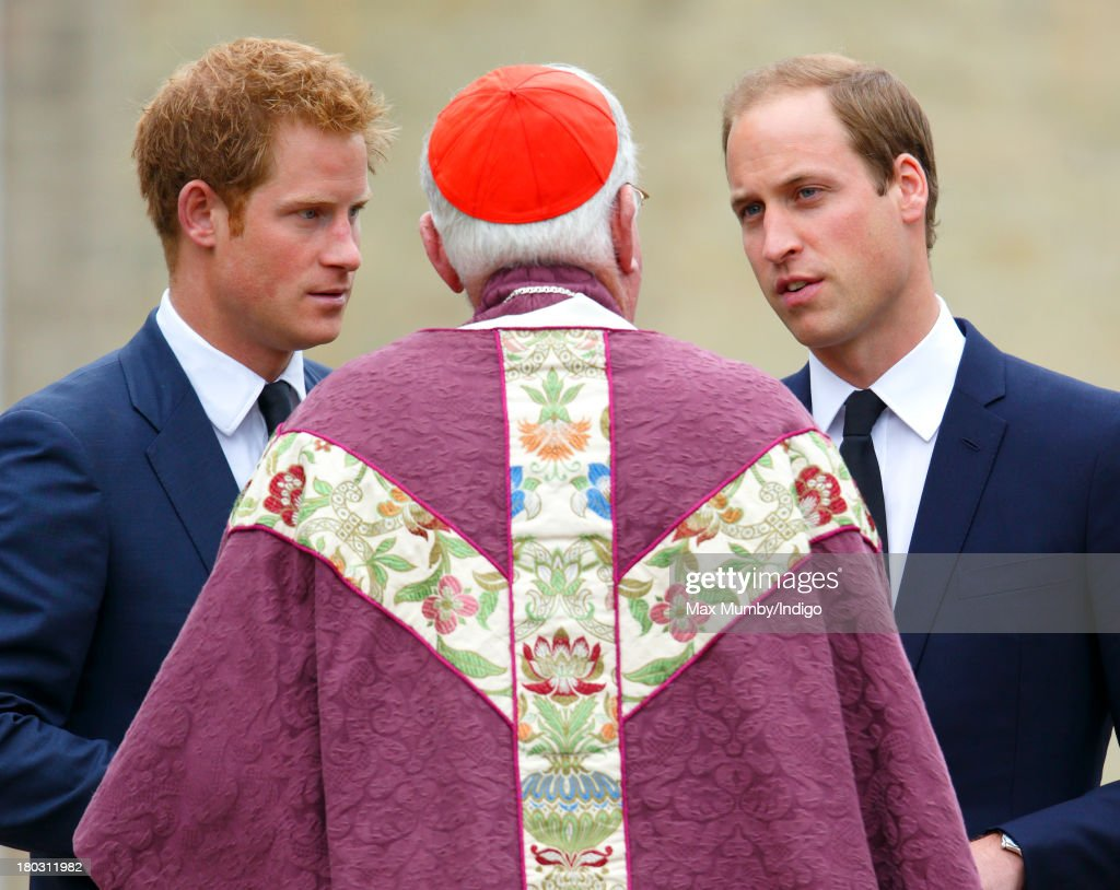 Prince Harry and Prince William, Duke of Cambridge talk with Cardinal Cormac Murphy-O'Connor as they attend a requiem mass for Hugh van Cutsem who passed away on September 2nd 2013, at Brentwood Cathedral on September 11, 2013 in Brentwood, England.