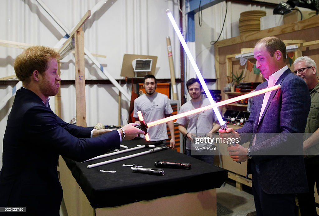 Prince Harry (L) and Prince William, Duke of Cambridge try out light sabres during a tour of the Star Wars sets at Pinewood studios on April 19, 2016 in Iver Heath, England. Prince William and Prince Harry are touring Pinewood studios to visit the production workshops and meet the creative teams working behind the scenes on the Star Wars films.