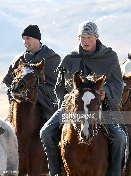 Prince Harry and Prince William ride horses as they arrive to visit a child education centre on June 17 2010 in Semonkong Lesotho The two Princes are...
