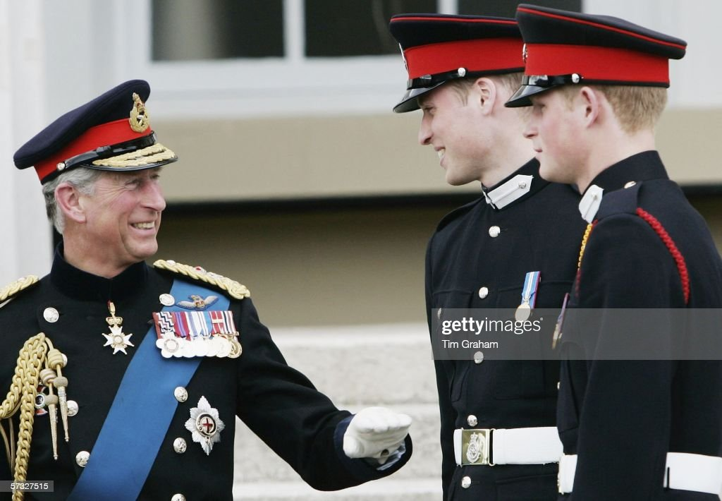 Prince Harry (R) and Prince William stand on the steps of the Old College at Sandhurst Military Academy with their father Prince Charles, Prince of Wales after the Sovereign's Parade on April 12, 2006 in Surrey, England.