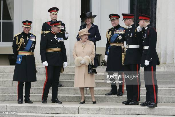 Prince Harry and Prince William stand on the steps of the Old College at Sandhurst Military Academy after the Sovereign's Parade with Prince Charles...
