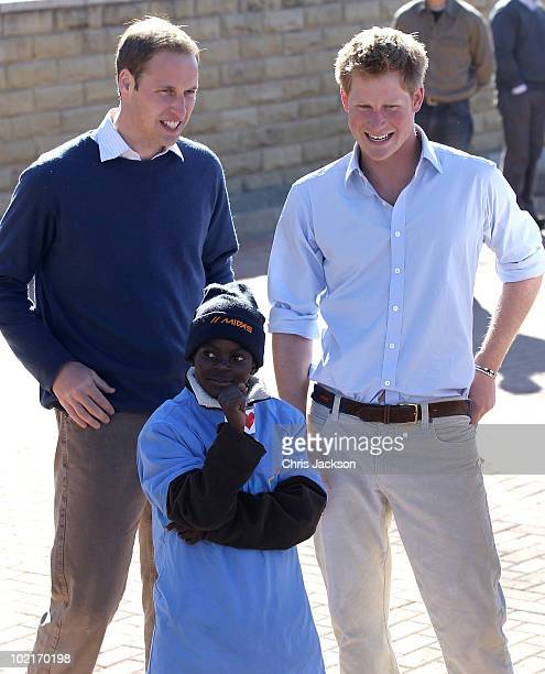 Prince Harry and Prince William take part in a game with HIV affected children at the Mamahato Network Club at King Letsie's Palace on June 17, 2010...