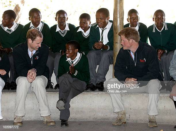 Prince Harry and Prince William talk to children as they visit the Mokolodi Education Centre on June 15 2010 in Gaborone Botswana The two Princes are...