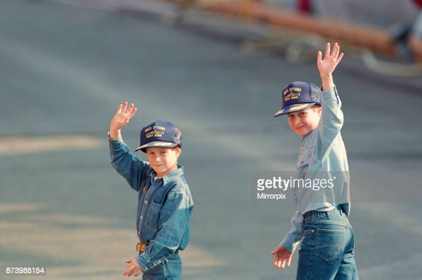 Prince Harry and Prince William wave to the cameras during their tour of Canada They are in Canada with their parents The Prince and Princess of...