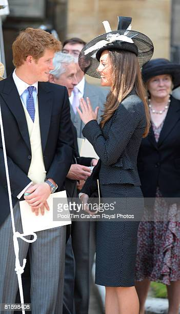 Prince Harry and Prince William's girlfriend Kate Middleton chat together as they watch the Order of the Garter procession at Windsor Castle on June...