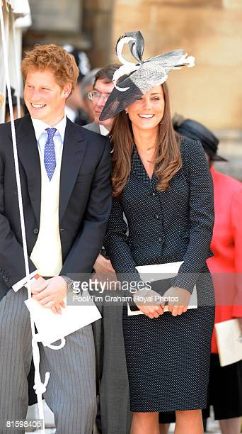 Prince Harry and Prince William's girlfriend Kate Middleton laugh together as they watch the Order of the Garter procession at Windsor Castle on June...