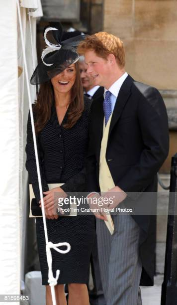 Prince Harry and Prince William's girlfriend Kate Middleton laugh together as they arrive to watch the Order of the Garter procession at Windsor...