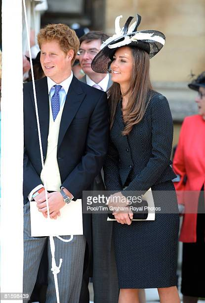 Prince Harry and Prince William's girlfriend Kate Middleton watch the Order of the Garter procession at Windsor Castle on June 16 2008 in Windsor...