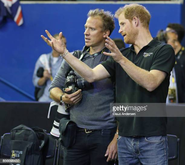 Prince Harry and Royal photographer Chris Jackson chat prior to medal presentations after the Gold medal game on Day Eight in Wheelchair Basketball...