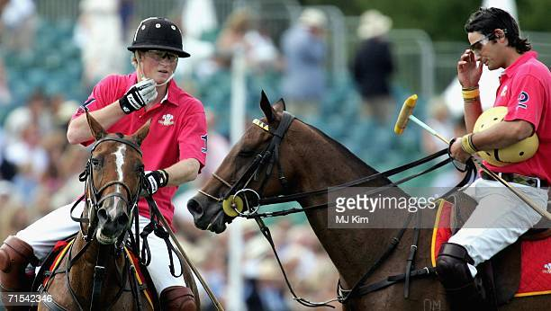 Prince Harry and Satnam Dhillon seen during The Cartier Cup between Prince of Wales' Team and Hurlingham at the Guards Polo Club on 30 July 2006 in...