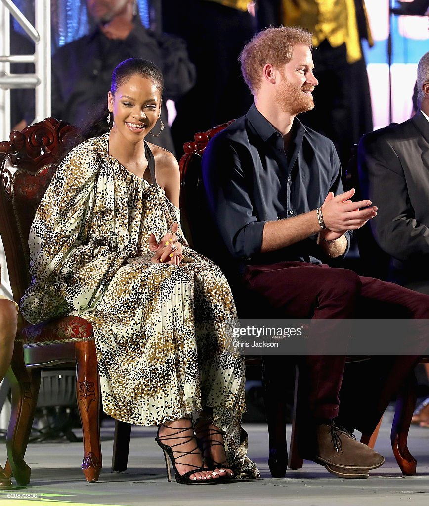 Prince Harry and singer Rihanna attend a Golden Anniversary Spectacular Mega Concert at the Kensington Oval Cricket Ground on day 10 of an official visit to the Caribbean on November 30, 2016 in Bridgetown, Barbados. Prince Harry's visit to The Caribbean marks the 35th Anniversary of Independence in Antigua and Barbuda and the 50th Anniversary of Independence in Barbados and Guyana.