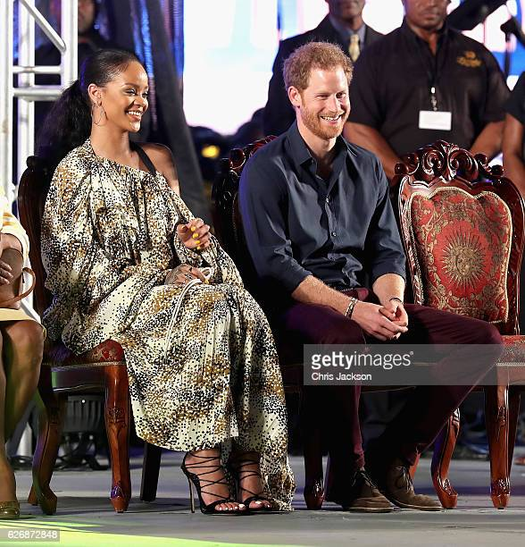 Prince Harry and singer Rihanna attend a Golden Anniversary Spectacular Mega Concert at the Kensington Oval Cricket Ground on day 10 of an official...