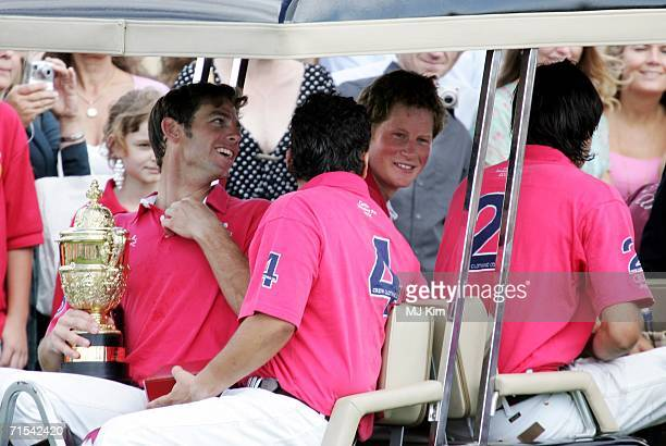 Prince Harry and team mates Satnam Dhillon Malcolm Borwick and Nacho Gonzalez of Prince of Wales' Team celebrating after beating Hurlingham during...