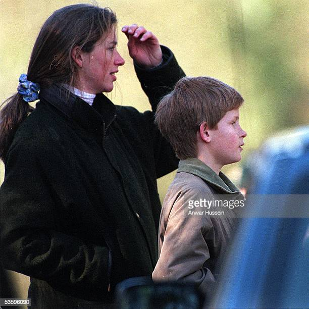 Prince Harry and Tiggy LeggeBourke watch Charles Prince of Wales take part in the Beaufort Hunt in March 1997 in Malmesbury England