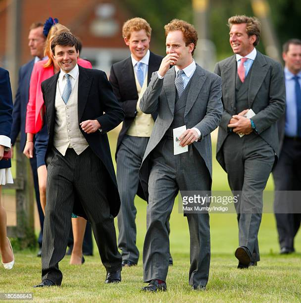 Prince Harry and Tom Inskip attend the wedding of James Meade and Lady Laura Marsham at the Parish Church of St Nicholas in Gayton on September 14...