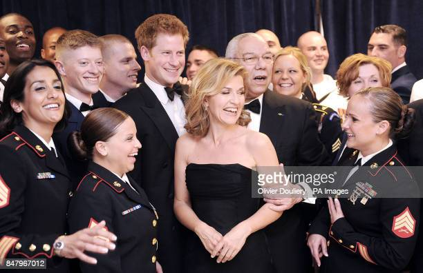 Prince Harry and violin virtuoso Anne Sophie Mutter pose backstage with former Secretary of State Colin Powell and members of the armed forces at the...