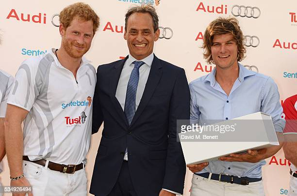 Prince Harry Andre Konsbruck Director of Audi UK and William MelvilleSmith attend day one of the Audi Polo Challenge at Coworth Park on May 28 2016...