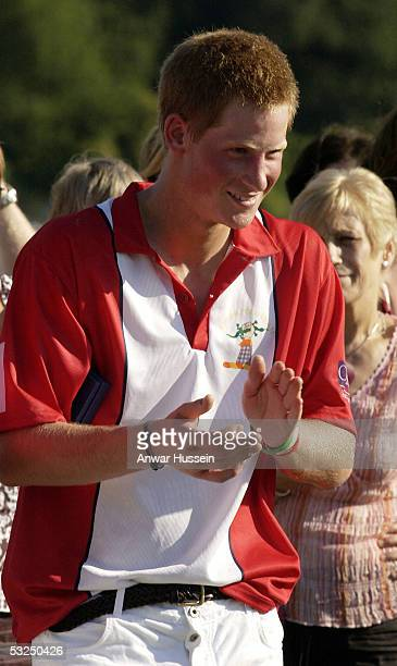 Prince Harry appplauds at the presentation after playing polo the Queen Mother Trophy and Corinium Bowl Doug Brown Cup Matches at Cirencester Park...