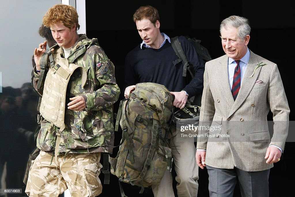 Prince Harry, army officer Cornet Wales is met by his father Prince Charles and brother Prince William as he returns to Britain at Royal Air Force RAF Brize Norton airbase after active service in Afghanistan on March 1,2008 in Oxfordshire, England.
