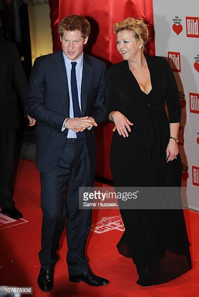 Prince Harry arrives at a charity gala for Ein Herz fur Kinder accompanied by chairwoman Marion Horn where he received a Golden Heart Award for his...