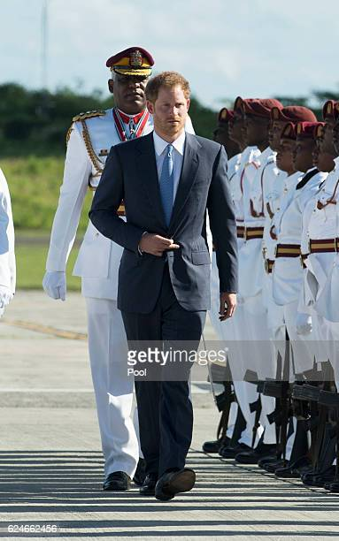 Prince Harry arrives at VC Bird International Airport on the first day of an official visit to the Caribbean on November 20 2016 in Antigua Antigua...