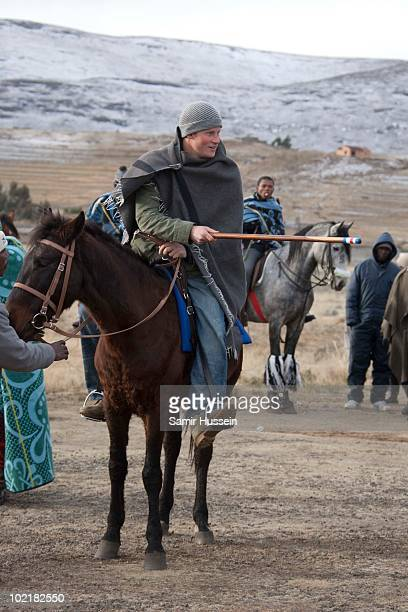 Prince Harry arrives by horseback at the Herd Boy School on June 17 2010 in Semonkong Lesotho The Princes are on a joint trip to Southern Africa to...