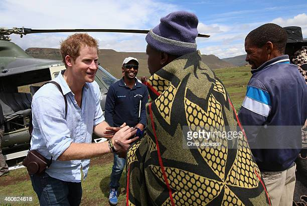 Prince Harry arrives for a visit to a herd boy night school constructed by Sentebale on December 8 2014 in Mokhotlong Lesotho Prince Harry was...