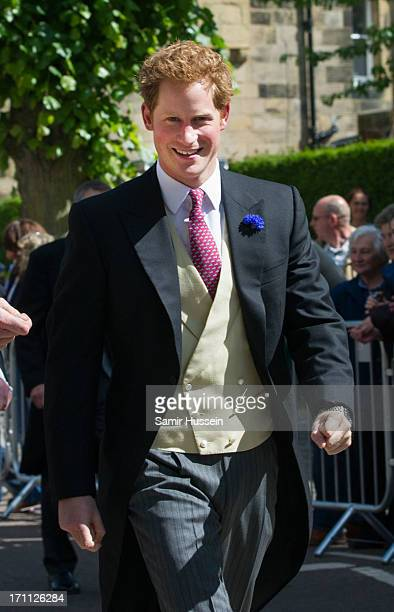 Prince Harry arrives for the wedding of Melissa Percy and Thomas Staubenzee at Alnwick Castle on June 22 2013 in Alnwick England