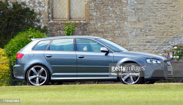 Prince Harry arrives in his Audi S3 car to play in the Jerudong Trophy polo match at Cirencester Park Polo Club on July 14 2013 in Cirencester England