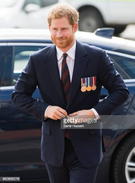 Prince Harry arrives to present 12 pilots from Course 17/02 of the Army Air Corps with their Wing during a ceremony at Museum of Army Flying on March...