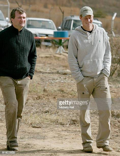 Prince Harry arrives with Geoffrey Mathews the Chief Executive of Sentebale at the LCCU on July 9 2008 in Maseru Lesotho Prince Harry and soldiers of...