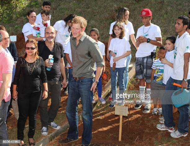 Prince Harry as he plants a tree at Cota 200 outside Sao Paolo where he viewed Mata Atlantica the Atlantic Rainforest and learnt about the Serra do...