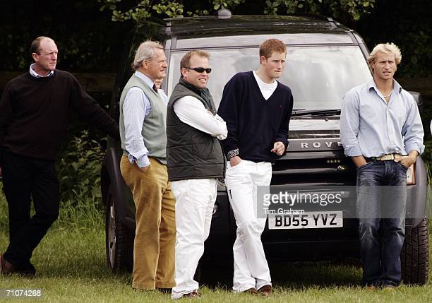 Prince Harry as Patron looks on with friends and bodyguard at a polo match sponsored by Kuoni as a fundraiser for Sentebale charity The Prince's Fund...