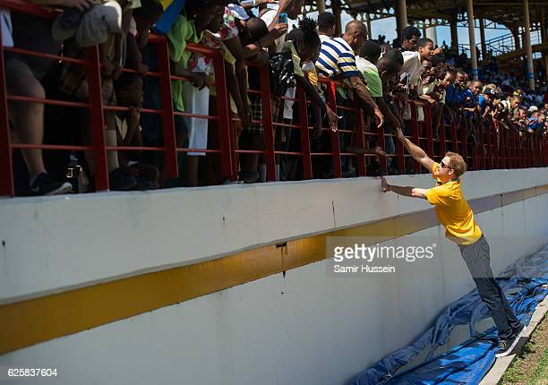 Prince Harry attenda a cricket match at the Darren Sammy Cricket Ground on the sixth day of an official visit on November 25 2016 in Castries Saint...
