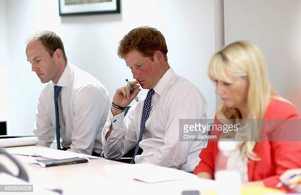 Prince Harry attends a planning meeting for the Invictus Games the Invictus Games Headquarters on September 4 2014 in London England The...