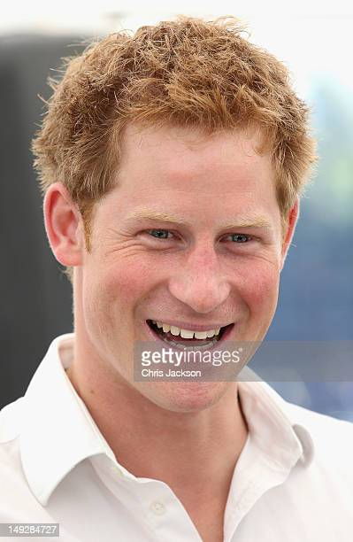 Prince Harry attends a reception as he visits Bacon's College on July 26, 2012 in London, England. Prince Harry, Prince William, Duke of Cambridge...