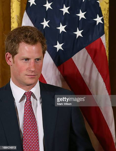 Prince Harry attends an event hosted by first lady Michelle Obama to honor military families at the White House on May 9 2013 in Washington DC HRH...