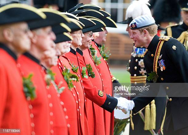 Prince Harry attends Founder's Day to meet In-Pensioners at the Royal Hospital Chelsea on June 9, 2011 in London, England. Prince Harry is attending...