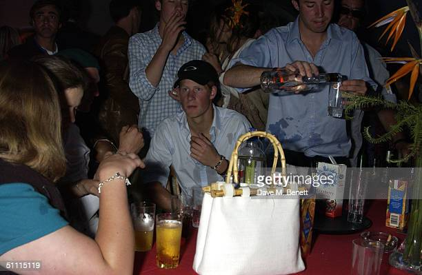 Prince Harry attends the afterparty at China White's club at Cartier International Day held at Guards Polo Club Windsor Great Park on July 25 2004 in...