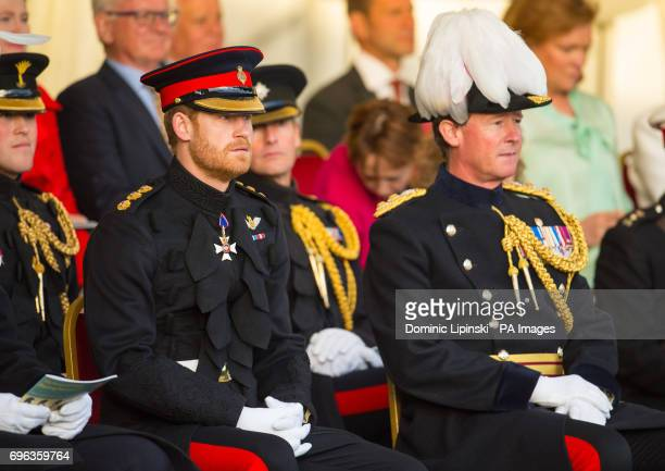 Prince Harry attends the annual Beating Retreat, which features over 750 soldiers, on Horse Guards Parade, London.