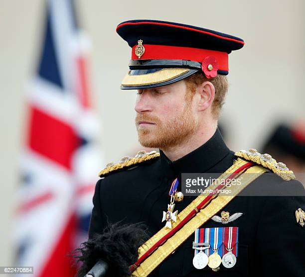Prince Harry attends the Armistice Day Service the National Memorial Arboretum on November 11 2016 in Alrewas England Armistice Day commemorates the...