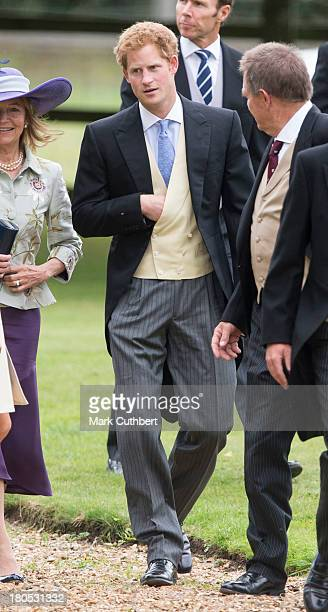 Prince Harry attends the wedding of James Meade and Lady Laura Marsham at The Parish Church of St Nicholas in Gaytonon September 14 2013 in King's...