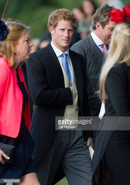 Prince Harry attends the wedding of James Meade And Lady Laura Marsham at Gayton Hall on September 14 2013 in King's Lynn England