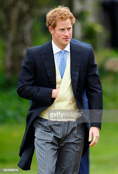 Prince Harry attends the wedding of James Meade and Lady Laura Marsham at the Parish Church of St Nicholas in Gayton on September 14 2013 near King's...