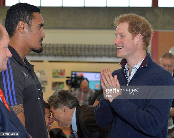 Prince Harry calls All Black Jerome Kaino ''a baby'' after seeing his injured finger as he visits Auckland Spinal Rehabiltation Unit on May 15 2015...