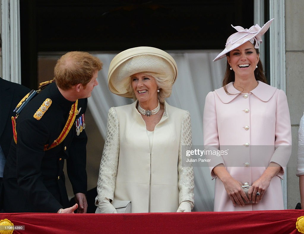 Prince Harry, Camilla Duchess of Cornwall, and Catherine Duchess of Cambridge appear on the balcony of Buckingham Palace after the annual Trooping The Colour ceremony on June 15, 2013 in London, England.