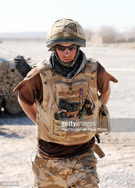 Prince Harry carries a 9mm pistol and wears body armour in the desert on February 18 2008 in Helmand province Southern Afghanistan