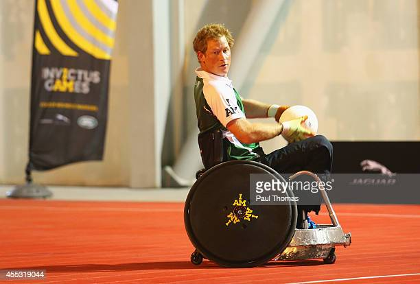 Prince Harry carries the ball during a training session for the Jaguar Land Rover Exhibition Wheelchair Rugby Match on day 2 of the Invictus Games...